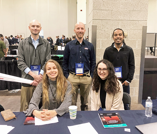 Picture of UM faculty and students at Physcon 2019. Carley Middleton and Makenna Tisor (undergrads) (front row). Joseph Brown (undergrad), Jake Bennett (assistant professor) and Anil Panta (grad student) (back row).